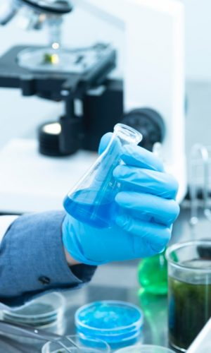 person-holding-laboratory-flask-2280571